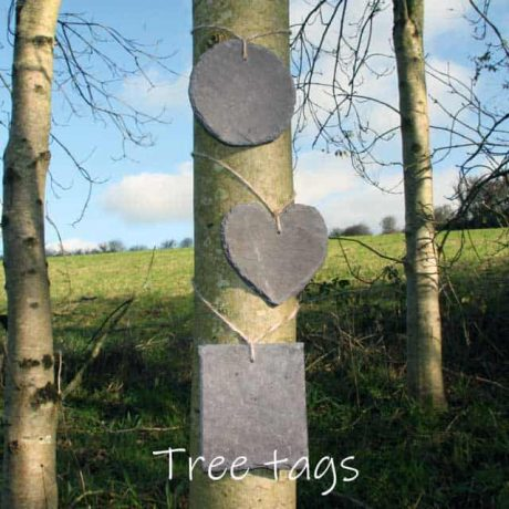 Various shaped tags made out of reclaimed Welsh slate